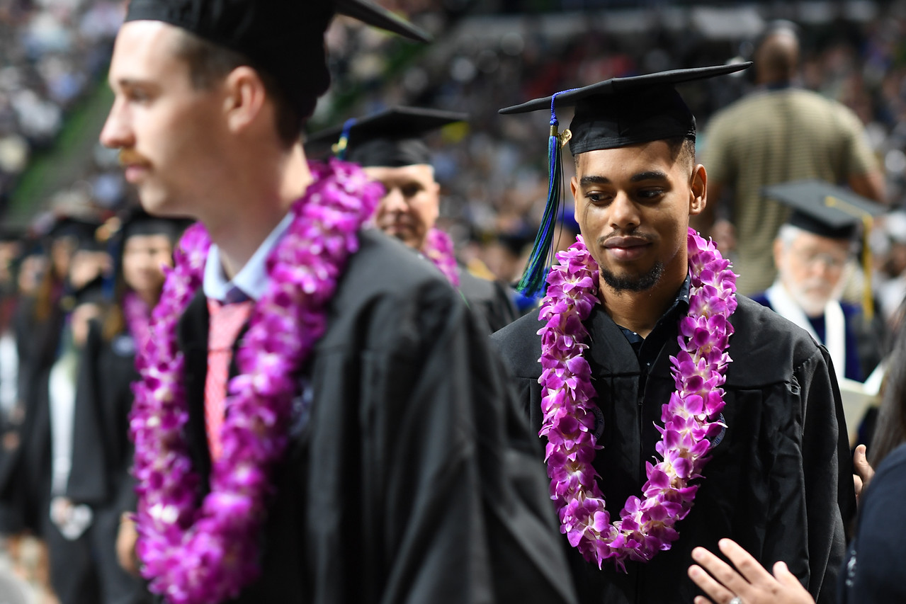 Islander graduates line up to walk the stage and receive their degrees.