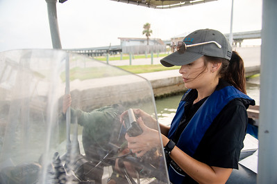 HRI Student Research Assistant, Desiree Corbiere initializes the boat GPS hardware during their lab in Aransas Bay.