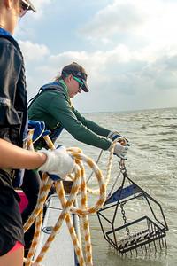 Danielle Zimmermann drops an oyster dredge at the Aransas Bay sampling station.