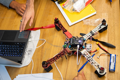 UAS Summer Program students initialize software on their drones.
