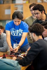 Team leader Selena Mendoza troubleshoots a drone during a team's start up procedure.
