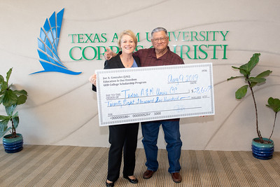 Dr. Kelly Quintanilla, President and CEO of Texas A&M University-Corpus Christi (left), and Nueces County Commissioner Joe A. Gonzalez.