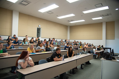 Students go over the syllabus for the introduction to ethics course.