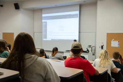 Students learn about blackboard in introduction to ethics course.