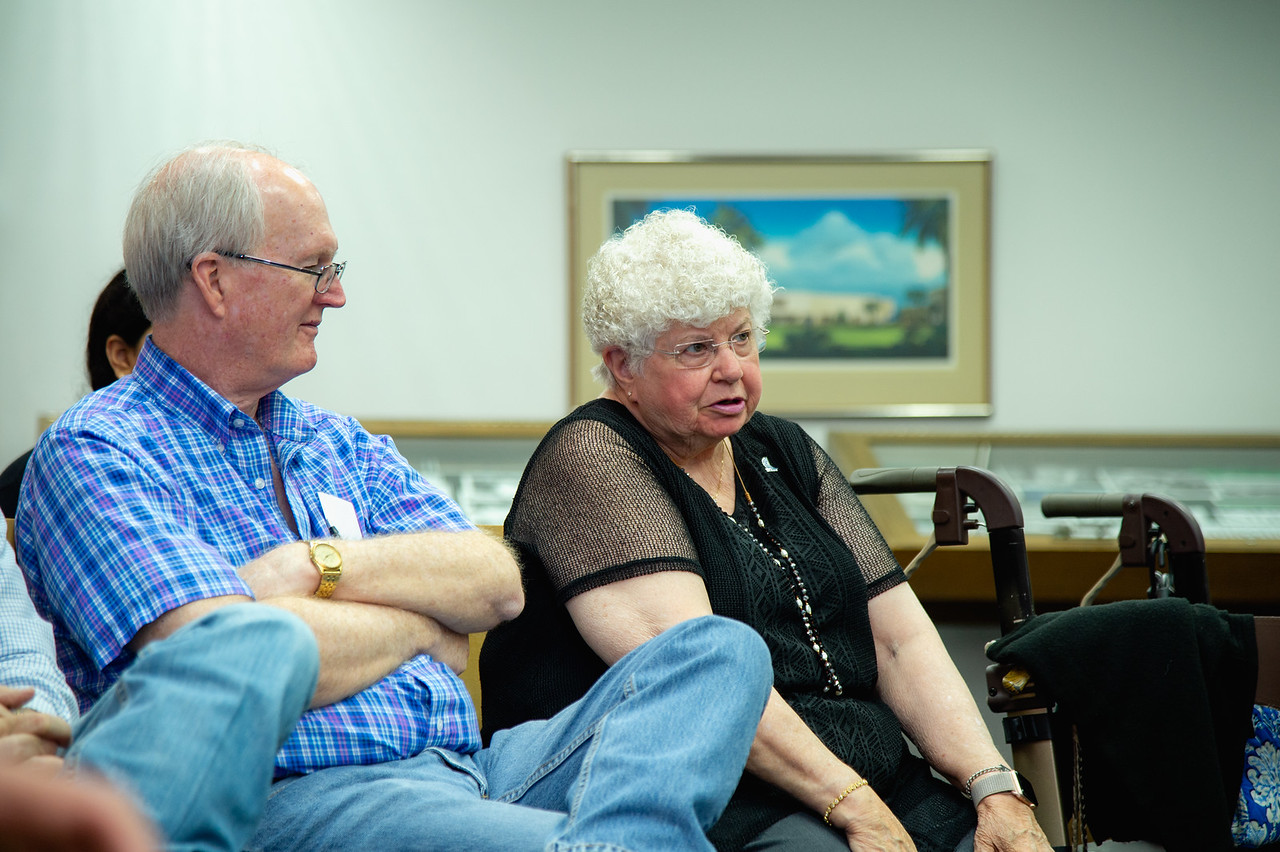Linda Landreth asks a question during the Q&A section of the forum.