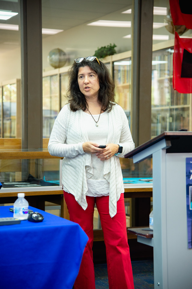 """Dr. Lisa Comparini gives her presentation during the """"100 Years After The Storm"""" forum."""