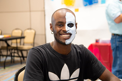 Kedran Wade gets his face painted at the Las Muralistas Community Painting event.