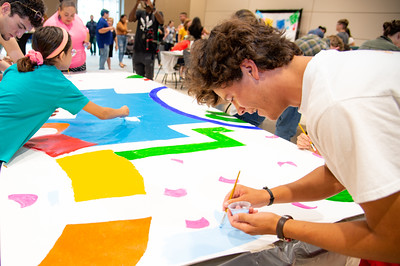 Members of the community come together to paint a mural in honor of Hispanic Heritage Month.