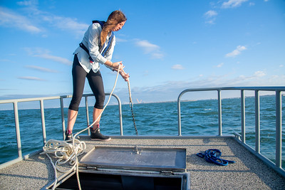 Lily Walker, a graduate research student, prepares to drop the anchor so she and her team can begin their experiment.