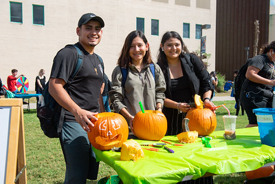 Sophomores Mario Martinez (left), Desiree Rodriguez, and Janine del Castillo carve pumpkins on East Lawn.