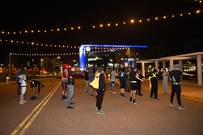ROTC Battalion runs in formation at the downtown Corpus Christi's sea wall on a cold Halloween morning.