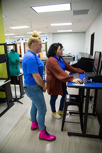 Soleil Garcia guides Kennedy Bontrager through the printing process in the I-Create Lab.