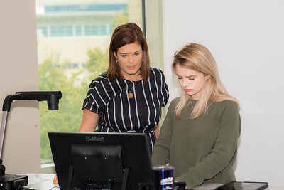 Chelsie Hawkinson assists student Haley Giles with scheduling her Digital Portfolio Presentation.