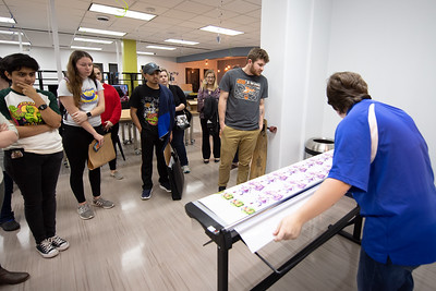 Student worker Autumn Hutchins leads a sticker making workshop in the Mary & Jeff Bell Library's I-Create Labs.