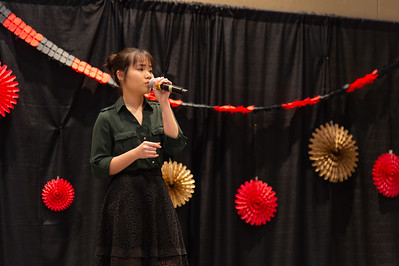 Ly Nyugen sings a Vietnamese song to kick off the celebration.