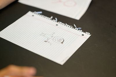 Riviera High School students draw a scientist based on their interpretations of one would look like during an exercise.