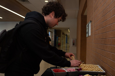 Adam Shelton picks out a cookie to decorate.