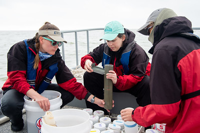 Danielle Zimmerman (left) Hannah Ehrmann, and Terry Palmer prepare their sediment samples from Baffin Bay.