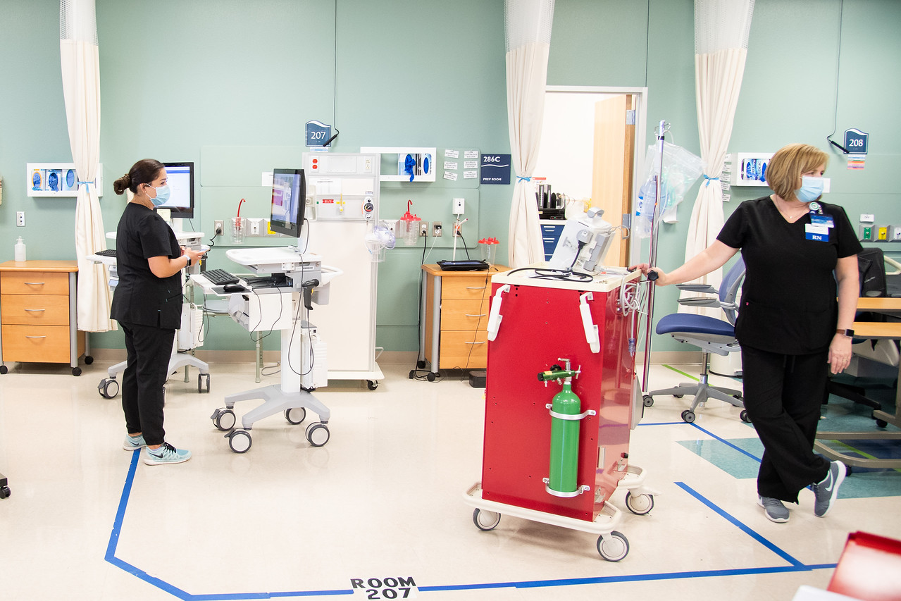 Simulation coordinators Ashley Dominguez (left) and Lisa Snell prepare for an online virtual simulation in the nursing lab.