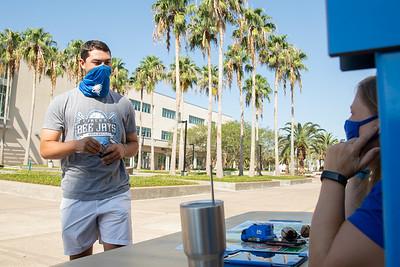 Sophomore Dylon Johnson, major in management picks up his Islander face mask.