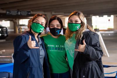 Members of the Islander campus community celebrate Fall 2020 graduates during the University's drive-thru diploma pick-up event on Jan. 23, 2021.