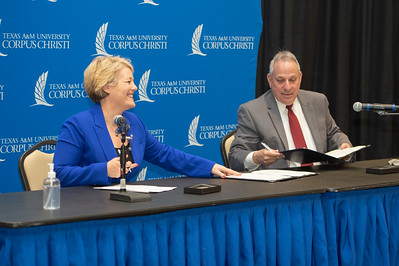 President/CEO of Texas A&M University-Corpus Christi Dr. Kelly Miller (left) and Premont ISD Superintendent of Schools Steve VanMatre during the MOU signing at TAMU-CC.