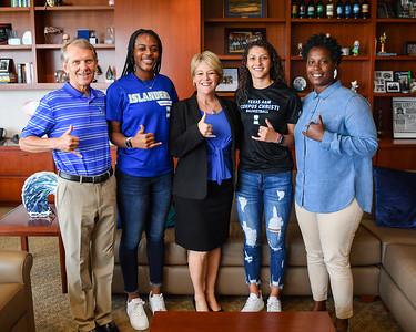 TAMU-CC Women's Basketball Head Coach Royce Chadwick, Alecia Westbrook, TAMU-CC President Kelly Miller, Makinna Serrata, and Assistant Coach Sherrie Tucker.