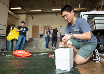 Kai-Wei Chang secures the payload containing ozone sonde that is tethered to a weather balloon.