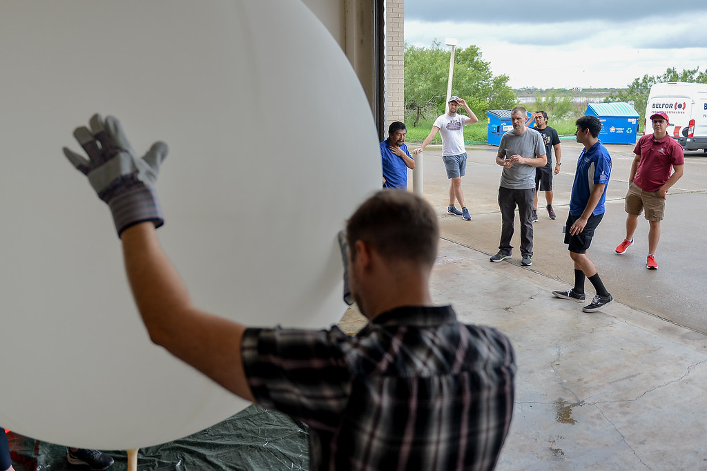 Participants of the TAMU-CC Ozone Sonde Workshop inflate a weather balloon.