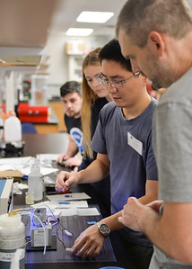Associate professor of physics at St. Edward's University, Paul Walter (right) guides Kai-Wei Chang through preparing an ozone sonde at TAMU-CC.