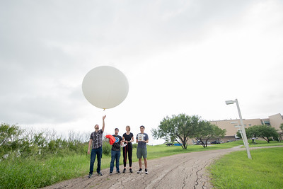 Lab coordinator Joseph Hill releases a weather balloon during the TAMU-CC Ozone Sonde Workshop.