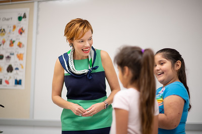 Dr. Bethanie Pletcher greets students Zadie Gallegos (8) and Jaleesa Ramirez (7) as they prepare for their reading tutoring session.