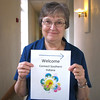 "May 29, 2009: Sister Barbara C. Schmitz hold a sign she's ready to post in a hallway to direct visitors to their program in St. Gertrude Hall. Sister Barbara helped coordinate the ""Connect with Southern Indiana"" program held at the monastery on May 29. She was a participant in the 2008 program."