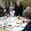 April 22, 2009: Sister Jennifer Miller greets Sister Mary Jane Kiesel, one of the staff from St. Joseph Parish in Jasper who attended the Administrative Assistants Day luncheon.