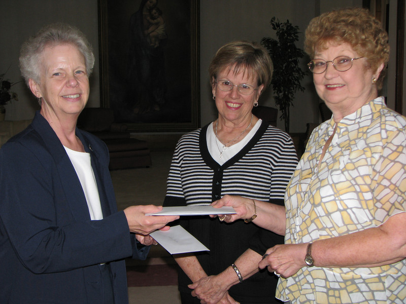 May 9, 2009: Sister Kristine Anne Harpenau accepts a check for $2,724 from Kathleen Boink, past president of the Academy Alumnae Association board, and Janie Nunning, current president. The funds were raised at the annual Alumnae Card Party on Aprill 22, 2009.