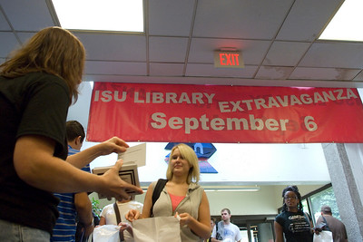 Freshman Marah Butler collects information and free giveaways as she enters the Library Extravaganza 2007 held at Cunningham Memorial Library on Thursday, September 6.