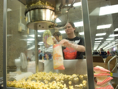 Holli Moseman fills bags of popcorn for students and staff during the  Library Extravaganza held on Thursday, September 6.