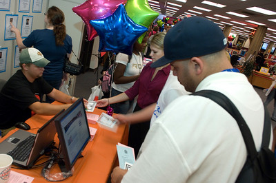 Senior Robert Trumpy reads information from the Learning Express Library booth during the Library Extravaganza held at Cunningham Memorial Library on Thursday, September6.