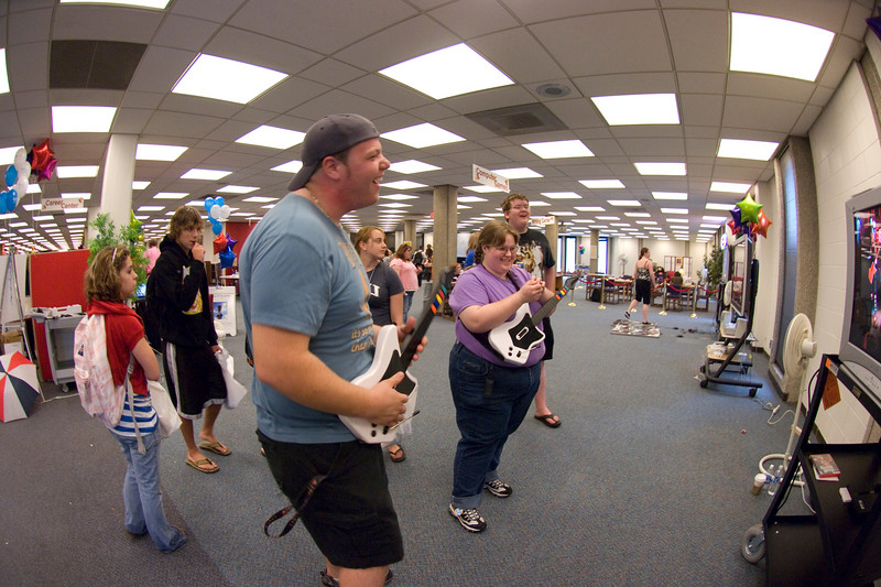 Transfer freshmen Mike Soberski and senior Amanda Coombes test out Guita Hero, one of the video games now available at the Cunningham Memorial Library during the Library Extravaganza held on Thursday, September 6.