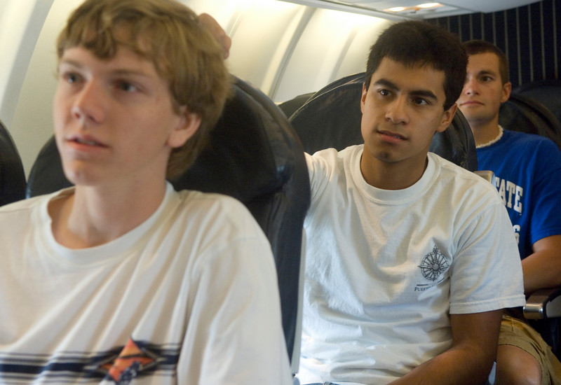 ISU aviation students Ken Branam, Ed Vargus and Brandon Charles (all sophomores) listen while an ASA representative gives information about the company inside a jet on Tuesday at Hulman Field.