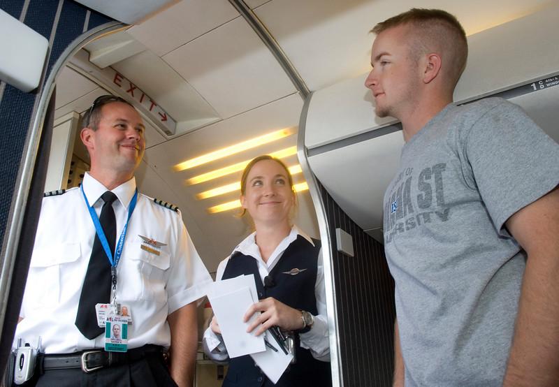 ASA pilot and ISU alum Darrin Greubel and ASA staff Rebecca Babb speak with ISU sophomore Michael Brunsman during a visit to Hulman field on Tuesday.