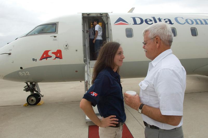 ISU senior Amy Schreel, an ASA intern, speaks with ISU aviation instructor Vernon Bothwell during ASA's visit to meet with students.