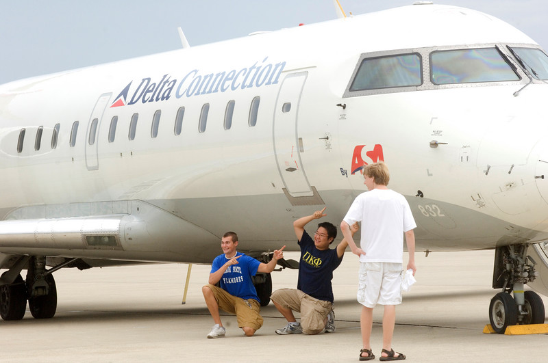 ISU aviation students Brandon Charles and Christopher Allen take a moment to pose for a picture with the ASA jet.