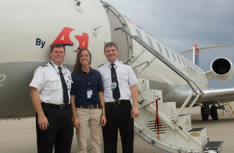 ISU senior Amy Schreel poses with ASA pilots outside the jet they flew in from the company's base in Atlanta on Tuesday during a campus recruitment trip. Schreel is currently interning with ASA.