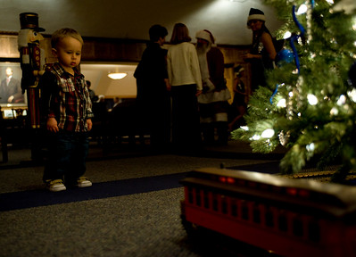 Landon Skinner, 17 months, watches the trains go by in Heritage Lounge prior to the production Babes in Toyland as part of the ISU Concert Series.