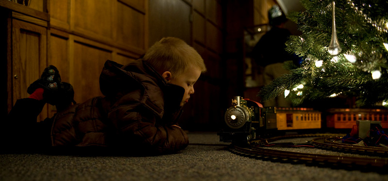 Camden Craft, 3, watches the trains go by in Heritage Lounge prior to the production Babes in Toyland as part of the ISU Concert Series.