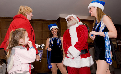 Sage Quast, 3, tells Santa Claus her Christmas list.
