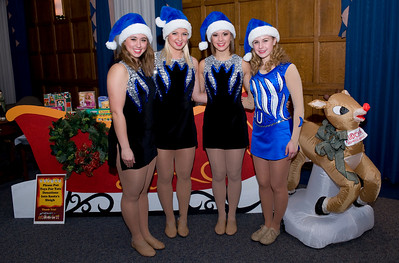 Sparkettes help collect toys for Toys for Tots.