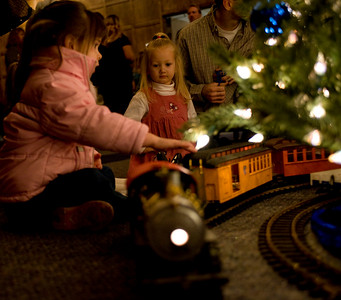 Madison Stafford, 3, and JayCee Vanesky, 3, watch the trains go by in Heritage Lounge prior to the production Babes in Toyland as part of the ISU Concert Series.
