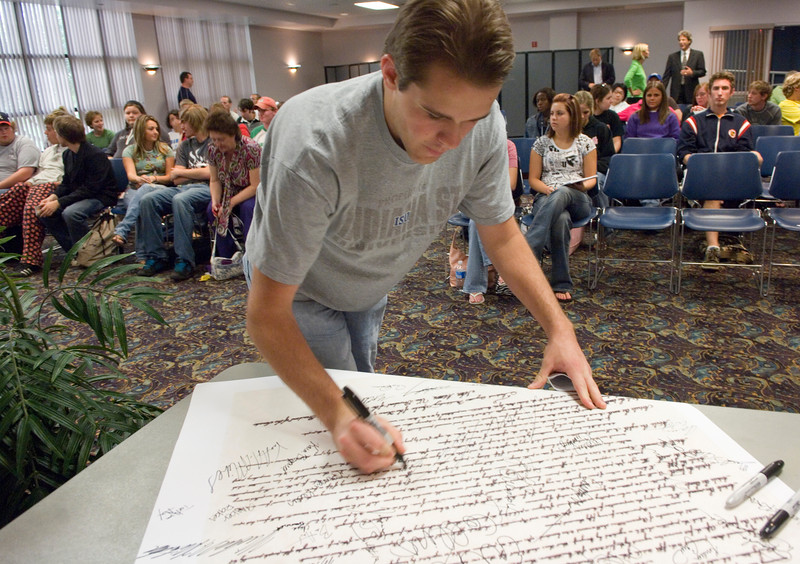 Senior ISU student and College of Arts and Sciences Senator Andrew Borden signs a copy of the constitution to celebrate the anniversary of the signing of the original.